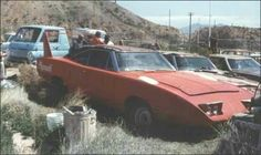Not one, but two Plymouth Superbirds thrown out to the curbside. Makes me sick!