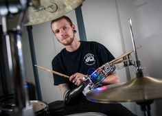 "Robotic prosthesis turns drummer into a three-armed cyborg | Scientists have created a robotic drumming prosthesis with motors that power two drumsticks. The first stick is controlled both physically by the musicians' arms and electronically using electromyography (EMG) muscle sensors. The other stick ""listens"" to the music being played and improvises."