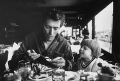 Watched by his three-year-old son Kyle, actor Clint Eastwood eats a crab in a Fisherman's Wharf restaurant, San Francisco, 1971. Photo: Bob Peterson, Getty Images