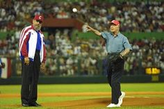 Cuban President Fidel Castro watches former US President Jimmy Carter throw a baseball prior to the start of a a friendly baseball match between two Cuban teams May 14, 2002 in Havana, Cuba. Carter is the first US President, in or out of office, to visit communist Cuba since the 1959 revolution that put Castro in power Fidel Castro – A Life In Pictures The Guardian