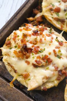Bacon Chicken Alfredo English muffins are an easy dinner recipe or perfect party snack. These baked English muffins are loaded with shredded rotisserie chicken, bacon, cheese and Alfredo sauce.