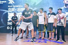 NBA player Klay Thompson of the Golden State Warriors meets fans at Happy Family Mall on June 26 2017 in Shenyang China