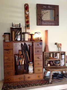apothecary drawers with antique sewing items