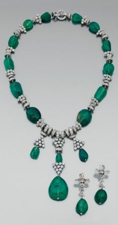 A rare Art Deco platinum, gold, emerald and diamond necklace, circa 1925. Accompanied by a pair of platinum, emerald and diamond earrings.