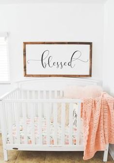 wood sign in nursery with floral crib sheet white crib. Pink fur pillow and peach crochet baby blanket Peach Nursery, Floral Nursery, Rustic Nursery Decor, Baby Room Decor, Nursery Artwork, Nursery Room, Church Nursery, Floral Crib Sheet, Baby Girl Nursery Themes