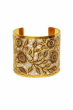 Sparkle and shine; a silver toned background is encased by floral Moroccan inspired cut outs. Wear with the other cuffs from this collection for advanced style. One size fits most, base is adjustable.   Tangier Cuff by Made It!. Accessories - Jewelry - Bracelets New Jersey