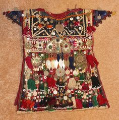 Historical Nomad Turkmen Cherjew Village Children's Ceremonial Garment, CA 1920's, #923 by CulturalPatina on Etsy https://www.etsy.com/listing/255734357/historical-nomad-turkmen-cherjew-village