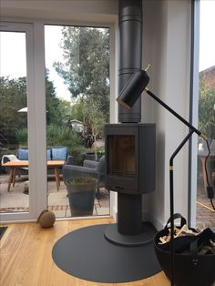 Here is a Contura 870 stove in grey with matching Poujoulat flue.