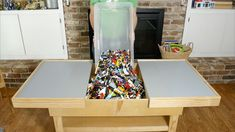 How to make a great lego table for four kids. Some woodworking skills are needed along with the tools. Awesome design, $5 for the pdf plans, pretty affordable