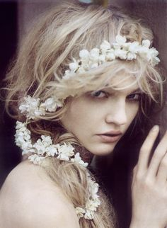 Floral crown of tiny white blooms that winds through your hair