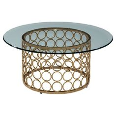 Showcase a fresh bouquet or your favorite art books on this stylish coffee table, featuring a lux gold-finished metalwork base and glass top.  ...