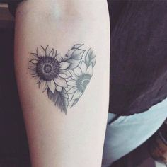 Sunflower tattoos for women aren& just for aesthetic value and artistic expression, they can also have specific interpretations and personal significance behind them. Explore the meanings behind sunflower tattoos here and see beautiful examples. Sunflower Tattoo Simple, Sunflower Tattoo Shoulder, Sunflower Tattoos, Sunflower Tattoo Design, White Sunflower, Sunflower Mandala Tattoo, Sunflower Tattoo Meaning, Sunflower Flower, Trendy Tattoos