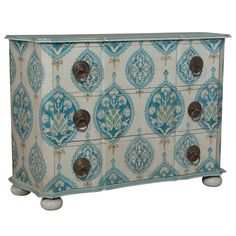 "The Jaipur chest provides storage to bedrooms and dining spaces with a refined take on bohemian style. A painted pattern reminiscent of Indian block prints adorns this furnishing in stunning shades of blue and creamy white. 66""W x 22""D x 46""H. Wood. 3 drawers. Wipe with soft, dry cloth to clean."