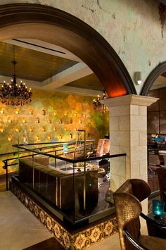 Gold hologram foiled walls in the VIP lounge. Faux wood grained arches and Old World Cuban influenced walls. By Spiegel's Decorative Finishes.