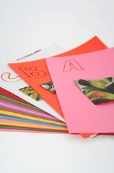 Make an alphabet book with construction paper, markers and old magazines.