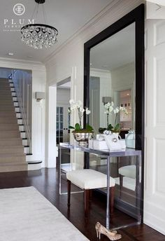 Chic foyer design with Arctic Pear Chandelier, espresso wood framed floor mirror, polished chrome modern console table