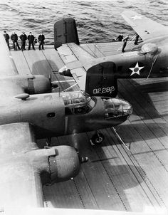 B-25 Mitchell bombers and air crewmen on the flight deck of USS Hornet April 1942.