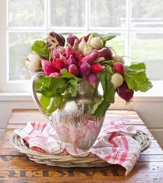 Radish centerpiece: A vintage silver water pitcher shows off bundles of red and white radishes, secured with rubber bands around the stems. More summer centerpiece ideas:  http://www.midwestliving.com/homes/seasonal-decorating/25-colorful-summer-centerpieces/?page=10