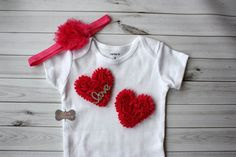 This adorable set is sure to be the perfect outfit for your little love!  This creation starts with a Carters one-piece (available in newborn, 3 mo, 6 mo, 9mo, 12 mo, or 18mo) that is topped with two beautiful pink hearts and topped with a sparkly rhinestone that pretty much says it all...love! LONG SLEEVE ONE PIECE ALSO AVAILABLE:)  The listing allows you to add on the matching headband made with soft, stretchy, pink elastic and topped with a pink matching shabby...a great way to complete…