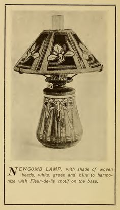 Newcomb pottery lamp with shade of woven beads, white, green and blue to harmonize with Fleur-de-lis motif on the base. From their 1905 catalog.