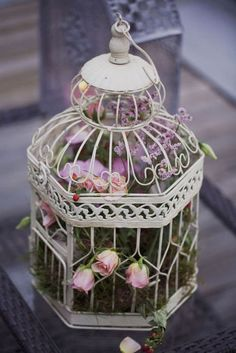 Decorative birdcage and flowers.