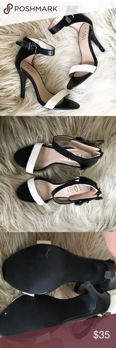 """Tobi Black White Open Toed Ankle Strap Heels Tobi black and white open toe ankle strap heels. Great dressy heel to lengthen the look of your legs.  • Excellent, hardly worn condition • Ankle buckle strap, back zip closure • 3"""" stiletto heel • Leather and man made materials Tobi Shoes Heels"""