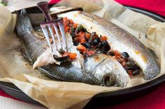 Mediterranean baked Stuffed Sea Bass recipe with Tomatoes, Lemons and Olives
