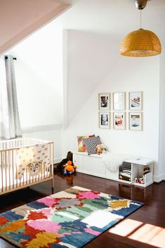 Sometimes all the bright color in a nursery can come from one source. Using a rug that is multicolored and patterned makes for a chic gender-neutral nursery solution perfect for those chubby little knees