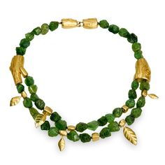 18K, 22K & 24K yellow gold, unpolished tsavorite garnet beads A single strand of natural green garnet beads makes it's way to a double strand as the branche