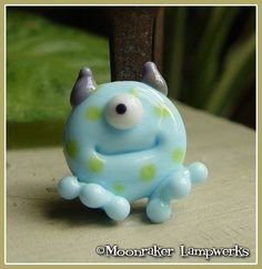 Blue Spotted Lil Monster Halloween Lampwork Bead by moonrakerbeads,
