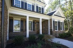 FRONT PORCHES WITH IRON RAILING   Rosemont Floorplan: Front Porch with columns and iron railing Royal ...