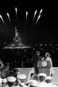 """PRESIDENT RONALD REAGAN and FIRST LADY NANCY REAGAN watch the FOURTH OF JULY FIREWORKS at the Statue of Liberty  from the deck of aircraft carrier """"U.S.S. John F. Kennedy.""""  -- July 4, 1986."""