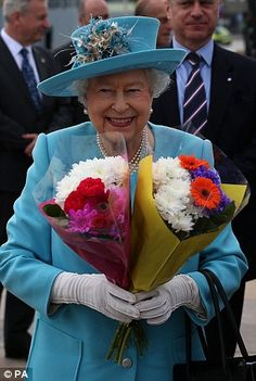 The popular Queen was presented with several bunches of flowers during her official engagement today