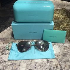 Authentic Tiffany & co sunglasses Beautiful authentic Tiffany & co sunglasses silver Frame with bow on the sides in great condition other then a small spot on the bottom on right lens as shown in pic comes with original box and certificate Tiffany & Co. Accessories Sunglasses