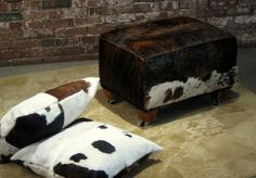 Custom cowhide ottoman designed to roll anywhere, over anything. #rugged #elegant & #pure