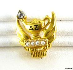 """My Delta Zeta Badge: The DZ pin is featured in the Smithsonian Museum in the American Fraternal & Sorority Collegiate section and is designated as """"The country's most beautiful sorority pin"""" and was also honored as an """"Exceptionally Beautiful  Organizational Piece"""" by Tiffany & Co. in 1967."""