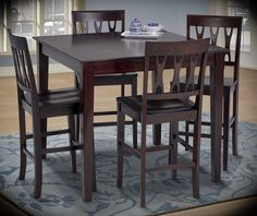"""Counter Height Dining Set Abbie Bordeaux Table: Width: 42"""" Height: 37"""" Depth: 42"""" Chair: Width: 18"""" Height: 42"""" Depth: 19"""" This sleek and stylish 5 piece counter height dining collection brings life to your dining area with its elegant cut-out detailed seat backs, tapered wood legs, and a deep finish in bordeaux atop birch solids an basswood veneers."""