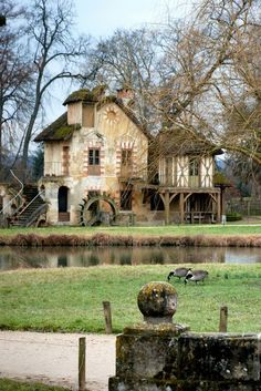 Beautiful Grist mill. This was part of Marie Antoinette's home built in 1783 - The Queen's Hamlet in Versailles, France.