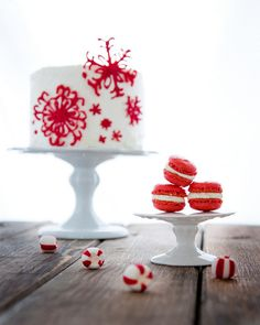 Christmas cake with red fondant snowflakes. Red and white Macarons.