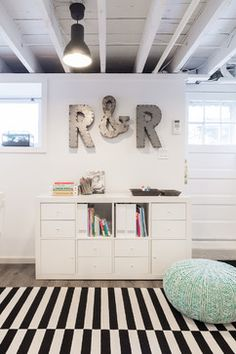 HGTV presents a fun art studio for kids in the low-ceiling basement of a Colonial. The transitional room features contemporary cabinets and furnishings, and the rafters were exposed and painted white to create a feeling of greater space. Kids Basement, Basement Office, Basement Bedrooms, Basement Bathroom, Basement Ideas, Basement Decorating, Unfinished Basement Playroom, Basement Studio, Basement Layout