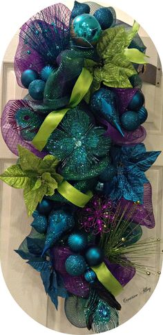 Wreath door hanging mantle or centerpiece Stunning by CreateAlley on Etsy Peacock Christmas Tree, Turquoise Christmas, Christmas Swags, Purple Christmas, Colorful Christmas Tree, Holiday Wreaths, Christmas Themes, Christmas Holidays, Christmas Crafts