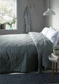 Crafted from pure cotton with a cosy filling, our lightweight quilted bedspread is soft dove grey in colour, with cross-stitch detailing. Perfect for draping across a king-size bed, it will add a soft splash of colour to classic white bedlinen, or pairs beautifully with our Washed Linen Bedding - Soft Blush.