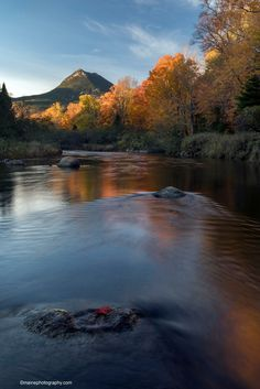 Another beautiful day in Baxter State Park.   The temperature dropped and it was rather windy, but the leaves are still holding on.    I was able to get out late in the day for sunset to capture this image of Doubletop Mountain.  I slipped on my Ranger hip waiters and stood in the middle of the river for nearly an hour.  So peaceful except for the swirling waters and light wind in the trees.   Feel free to share!