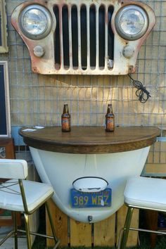 Bug hood with jeep grill made into a bar table