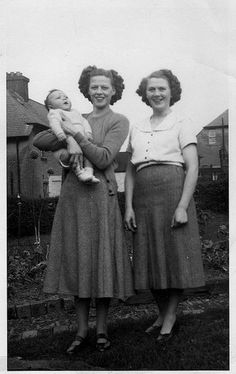 MARY (HOLDING BABY) AND SISTER CARRIE  AT HUTCHISON FAMILY HOME 9 ANDREW STREET, LOCHGELLY, SCOTLAND.