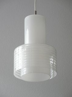 Very rare original 60s Putzler glass pendant lamp in very good condition. The bottom is a Oplaglas above clear glass was designed me acid in spiral