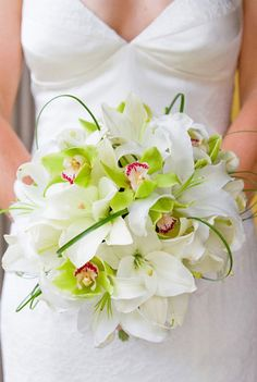 Perfect green orchid bouquet.  This is simple and beautiful. Would want to add something the exact color of leahs dress.