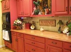 red stained kitchen cabinets in a log home - Google Search