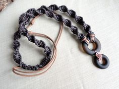 Eco Friendly Brown Bottle Top Glass Sand Tumbled Pendant  Repurposed Recycled Spiral Macrame Cord 415201301. $35.79, via Etsy.
