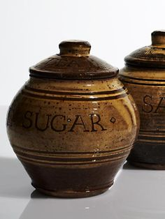 Storage jars by Michael Cardew. Lidded.